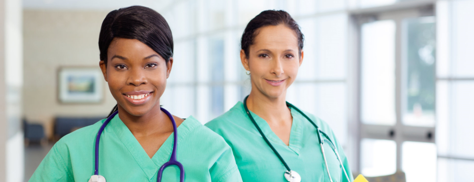 Two healthcare trainees wearing green uniform